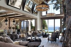 lake or beach house...either way a great view and the hanging mirrors are an interesting touch to reflect that fireplace.