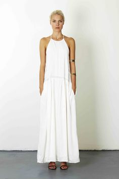 Loose fit maxi dress featuring and exposed zip on the back and a knee high split in the dress.