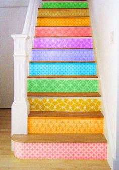 Love this idea of rainbow stairs. I've seen a lot of colourful stairs but they're usually painted on the flat bits that are trodden on. That would wear off/damage far more quickly than this.