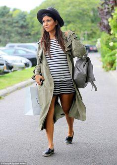 Kourtney Kardashian shows off bump in a classy dress during boat ride #dailymail