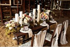 Varying heights of candle holders keep the centerpieces from getting too boring