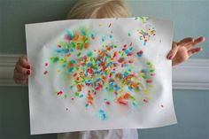 Sprinkles, water in a spray bottle, blow off sprinkles, done!  Little Page Turners: Easiest 4th of July Craft Ever