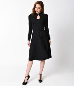 Retro and alluring, what could be better? From Voodoo Vixen is a delightfully dramatic black dress with all the feminine grace you need! Crafted in a soft stretch blend, a classic sultry keyhole neckline is brought together with an adorable black button w