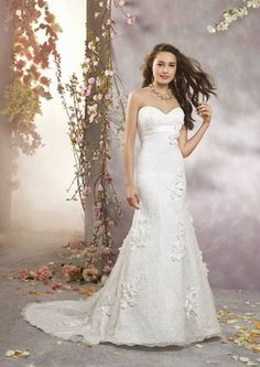 Looking like an exquisite flower in a fit and flare wedding dress from Alfred Angelo