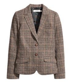 Fitted, two-button blazer in a woven wool-blend fabric with classic collar and lapels. One chest pocket, welt pockets at front with flap, and one inner pocket with button. Vent at back, elbow patches, and buttons at cuffs. Lined.