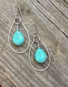 """Turquoise magnesite earrings. Blue teardrops with a hammered silver hoop. Approx 2"""" in length. Very light weight and great movement!"""