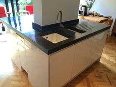 10 Black Oxide Polished Concrete Island Unit With Sink On One Side And Cantilever
