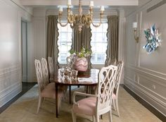Love the taupe walls with trim and the gorgeous silk ruffle panels.  @The Peak of Tres Chic