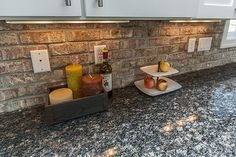 """Close up shot of a thin brick kitchen backsplash. Achieve a similar look with our Ravenna tile and an installation technique known as """"floating the grout"""". Visit our website for more information."""