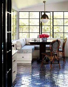 santa barbara style. tile, big paned windows, cushy cushions (real articulate i know)