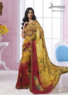 This yellow & maroon color georgette material saree with multi color border & with  multi color flowers prints.
