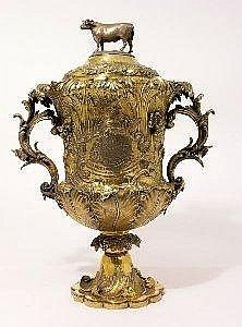 A William IV silver gilt two handled trophy cup and cover, o