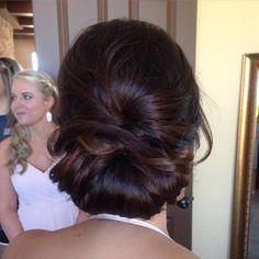 low soft chignon undo for a bridesmaid or bride on a brunette