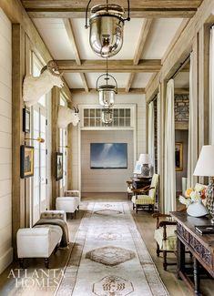 A 28-foot-long Oushak rug and linen sheers dress up the entry foyer, which is illuminated by large bell jar lanterns from The Urban Electric Co. Urban Electric, Enchanted Home, Atlanta Homes, Architect House, Entry Foyer, Ship Lap Walls, Formal Living Rooms, Living Spaces, Make Design