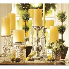 I love the variety of glass mixed with the little topiaries.  Slightly vintage, but definitely chic.