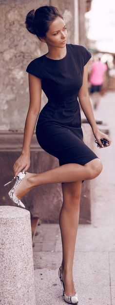 Black dress, printed pumps, up-do.