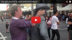 Guy gets punched by street performer! Original