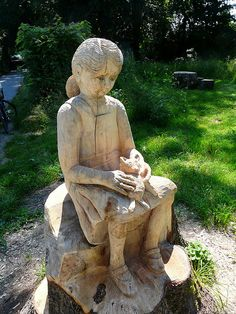 Girl Sitting on a Tree carved Stump