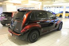 As a PT Cruiser owner, I cannot help but admire this badass paint job. The car artist did 7 coats of paint, alternating between black and colored to achieve this look. The color changes depending on where the light is hitting it.