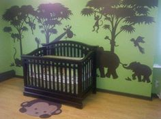 Love the animal / jungle shapes on the wall of this boys nursery!