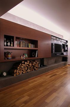 WoARCHITECTS I WORK I PG HOUSE #woarchitects #fireplace #iroko #homecinema #cement www.woarchitects.gr