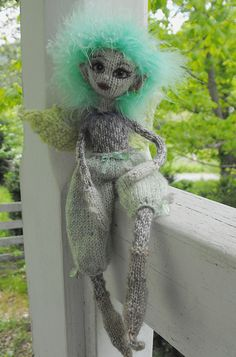 """""""Sprig""""  hand knit by Jeanne Lawrence. Based on """"Knitted Fairies to Cherish & Charm"""" by Fiona McDonald."""