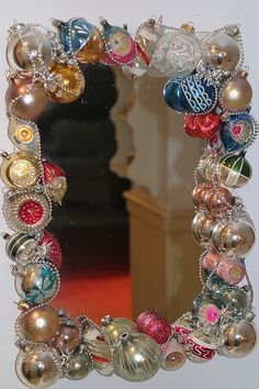 Christmas Ornament Mirror ~ Glue vintage ornaments and beaded garlands to an inexpensive Walmart mirror for a pretty, vintage-look decoration.