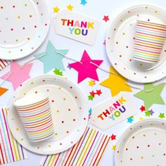 Bright and colourful rainbow unicorn party plates, cups and napkins