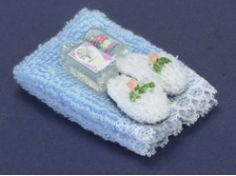 Blue towel set with lotion miniature