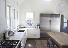 Suzie: Heather A Wilson, Architect - Modern farmhouse kitchen with no top cabinets, vaulted ...