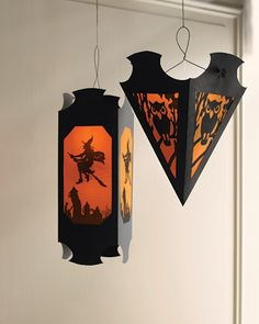 Free Templates for Hanging Vellum Halloween Lanterns~  These spooky lanterns can also be hung above your Halloween table for a dramatic effect.