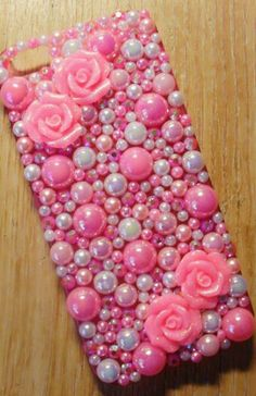 "Alright! This phone case is done in ""Bling"" type Decoden. It's where you use all rhinestones or pearls by hot glueing instead of silicone ""whip cream"". I really like how this one came out and I have to say, it is very pink."