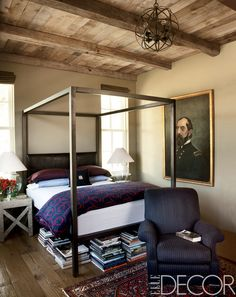The ceiling and beams in a guest room in the Sonoma County, California, home of Patrick Printy and Dan Holland are reclaimed oak. A Room & Board bed has a custom-made headboard, the antique armchair is covered in a Holland & Sherry wool, and the portrait of a Civil War general was found in North Carolina.