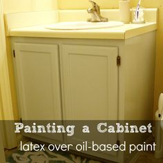 Painting a Bathroom Cabinet (and how to paint over oil-based paint with latex paint)