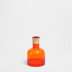 METAL AND ORANGE GLASS VASE
