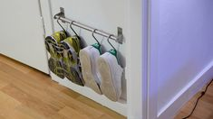 Super compact shoe storage using GRUNDTAL - IKEA Hackers. A clever reworking of over door shoe hangers, allowing for larger and muddy footwear.