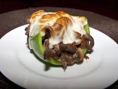 Philly Cheesesteak Stuffed Peppers  1 lb Thinly Sliced Sirloin Steak (or you can use deli roast beef)   ;         8 Slices Provolone Cheese      ;       4 Large Green Bell Peppers    ;      1 Medium Sweet Onion       ;      1 pound White Mushrooms       ;      3 Tbs. Butter     ;      3 Tbs. Olive Oil      ;       Salt and Pepper