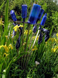I have some of this going on in my yard. I think I'll collect them all in one place this year, and make it more eye-catching. Click the link to see a ton of ways to do this. And if you don't want your blue bottles, I'll take them.