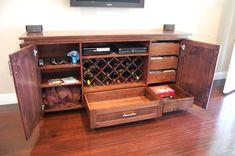 This entertainment unit is a custom design by myself and an artist to suit the clients taste. I built the entire unit around the wine rack. Four drawe… Room Organization, Wine Rack, Liquor Cabinet, Custom Design, Entertainment, The Unit, Wall Units, Storage, Diy