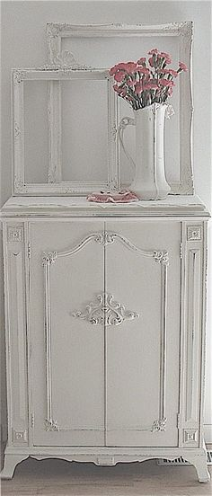 Love this shabby white cupboard!