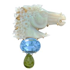 18 karat gold Carved opal horse Pin with blue topaz & peridot . Signed Sorab & Roshi