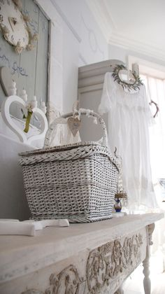 Wonderful white! Love the vintage clothing and little hair wreath and side table. Ana Rosa