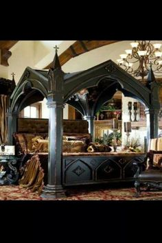Incredible Gothic style bed.  Looks like something the vampire Lestat would sleep the day away in.