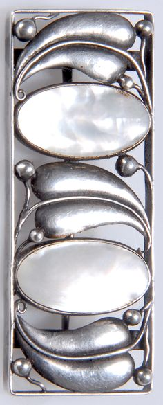 JOSEF HOFFMANN Brooch, ca. 1913, executed by Wiener Werkstätte, Vienna. Mother-of-pearl, silver, embossed, soldered. Marked at RIM: initials WW, Silver Hallmark (Diana's Head), needle marked 'A'. 2.2 x 5.2 cm.     SOLD $21,855.00 Germany 2009