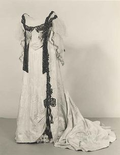 White silk ball gown with sequined chiffon sleeves and beaded black trim, by Jean-Philippe Worth, French, 1892-94.