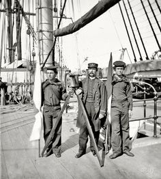 "The American Civil War; some men aboard a ship...Circa 1865. ""Signalmen of Rear Admiral John A. Dahlgren's flagship receiving a message from the Georgia shore."" Wet plate"