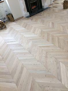 Oak Chevron parquet floor, doing the cuts round the perimeter of the border.