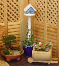 Dollhouse Miniature Birdhouse in Ceramic Planter - 1/12th Scale. $48.00, via Etsy.