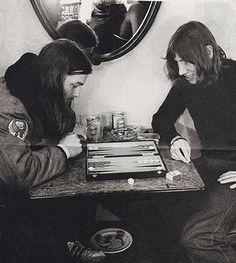 David Gilmour and Roger Waters of Pink Floyd playing backgammon.