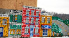 "Store front signage - part of the ""Read Between the Signs"" road sign art mural in Meadville, PA"